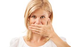 Smiling young woman covering mouth on white Royalty Free Stock Images