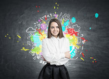 Smiling young woman and a creative idea Royalty Free Stock Photo