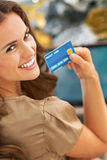 Smiling young woman with credit card using laptop Royalty Free Stock Photo