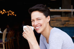 Smiling young woman with cup of coffee Royalty Free Stock Photos