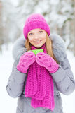Smiling young woman with cup in winter forest Stock Images