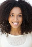 Smiling young woman with curly hair Royalty Free Stock Photos