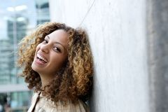 Smiling young woman with curly hair royalty free stock photography