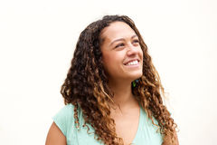 Smiling young woman with curly hair looking away Stock Image