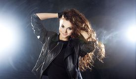 Smiling young woman dancing, hair flying Stock Images