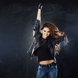 Smiling young woman dancing, hair flying Royalty Free Stock Image