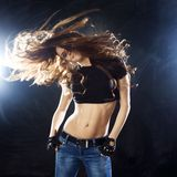 Smiling young woman dancing, hair flying Stock Photos