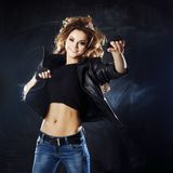 Smiling young woman dancing, hair flying Stock Photo