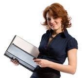 Smiling young woman with documents. The young woman in a business dress with documents in hands. White background Stock Image
