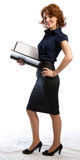 Smiling young woman with documents. The young woman in a business dress with documents in hands. White background Stock Photo