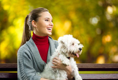 Smiling young woman with dog Royalty Free Stock Images