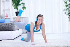 Smiling young woman doing exercise. Stock Image