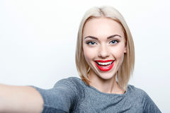 Smiling young woman doing selfie Stock Photo