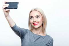 Smiling young woman doing selfie Royalty Free Stock Images