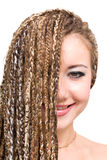 Smiling young woman with dreadlocks Royalty Free Stock Images