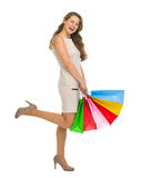 Smiling young woman in dress with shopping bags Stock Image
