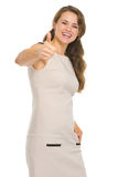 Smiling young woman in dress showing thumbs up Stock Photos