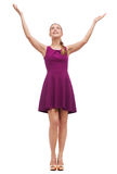 Smiling young woman in dress waving hands Royalty Free Stock Photo