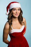 Smiling young woman dressed as Santa Claus Royalty Free Stock Photos