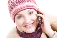A smiling young Woman dressed for winter talks a m Royalty Free Stock Images