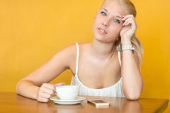 Smiling young woman drink coffee at cafe Royalty Free Stock Photo