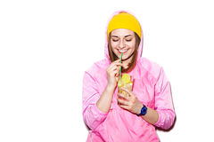 Smiling young woman drinking alcoholic cocktail Stock Photos