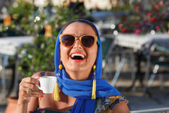 Smiling young woman drinking coffee Stock Images