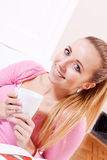 Smiling young woman drinking coffee Royalty Free Stock Images