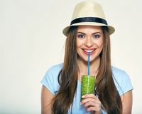 Smiling young woman drinking green  smoothie juice. Isolated portrait Stock Images