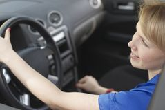 Smiling young woman-driver Stock Photo