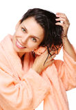 Smiling young woman drying hair with towel Royalty Free Stock Photo