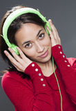 Smiling young woman with earphone relaxing to the sound of music. Listening to music concept - attractive 20s girl listening to music with headphone Stock Photography