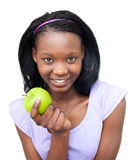 Smiling young woman eating an apple Royalty Free Stock Photo