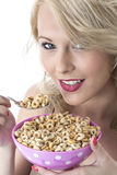Smiling Young Woman Eating Breakfast Cereals Royalty Free Stock Images
