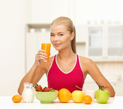 Smiling young woman eating healthy breakfast Stock Photo