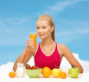 Smiling young woman eating healthy breakfast Royalty Free Stock Images