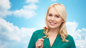 Smiling young woman eating vegetable salad Stock Image