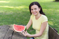 Smiling Young Woman Eating Watermelon Royalty Free Stock Photo