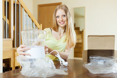 Smiling young woman with  electric steamer Royalty Free Stock Photos