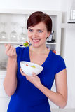 Young woman enjoying a healthy green salad Stock Image