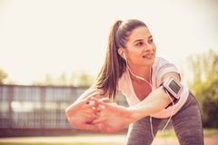 Smiling young woman exercise outside. stock images