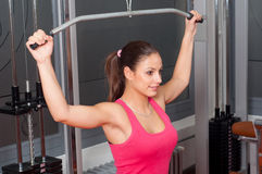 Smiling young woman exercising Stock Photography