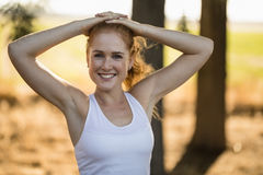 Smiling young woman exercising on sunny day at farm Royalty Free Stock Photo