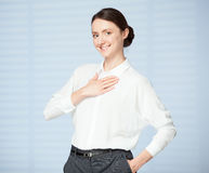 Smiling young woman expressing a thanks stock photo