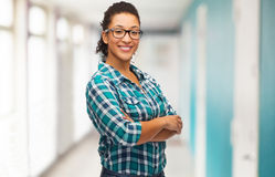 Smiling young woman in eyeglasses at school Royalty Free Stock Photos