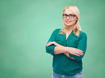 Smiling young woman with eyeglasses Royalty Free Stock Photo