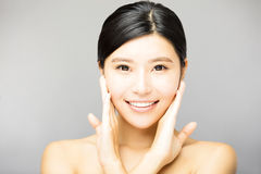 Smiling young  woman face with clean  skin Royalty Free Stock Image
