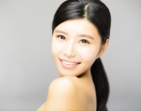 Smiling young  woman face with clean  skin Royalty Free Stock Photos