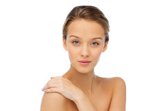 Smiling young woman face and shoulders Stock Photos