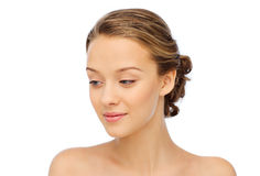 Smiling young woman face and shoulders Stock Photography